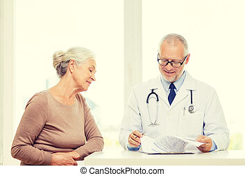 smiling senior woman and doctor meeting
