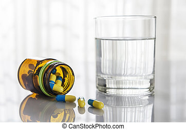 Medicine and glass - Taking medicine with a glass of water...
