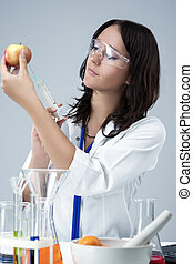 Medicine and Science Concepts. Caucasian Female Researcher Making Test Injection To the Fruits in laboratory.