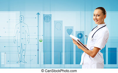 Medicine and technology - Young doctor in white uniform...