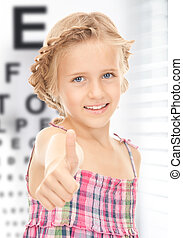 girl with optical eye chart - medicine and vision concept -...