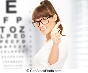 woman in eyeglasses with eye chart - medicine and vision ...