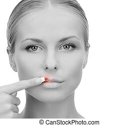 beautiful young woman pointing finger to her lips - medicine...