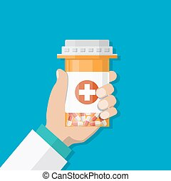 medicine bottle with red cross in hand of a doctor