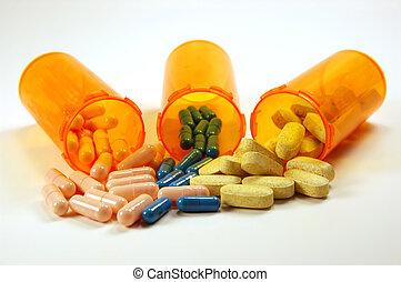 Medicine Bottles - Three medicine bottles spilling pills.