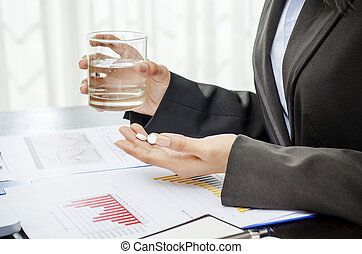 Medicine - Business person holding medicine and glass of ...