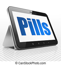Medicine concept: Tablet Computer with Pills on display