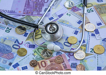 Medicine cost - Stethoscope over a stack of euros