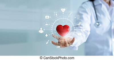 Medicine doctor holding red heart shape in hand with medical...