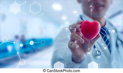 Medicine doctor holding red heart shape in hand with medical.