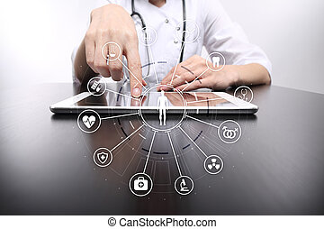Medicine doctor with modern computer, virtual screen interface and icon medical network connection.