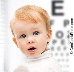 adorable baby child with eyesight testing board - medicine,...