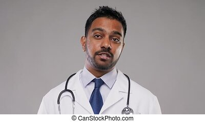 indian male doctor having video conference call