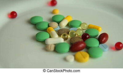Medicine overdose. Pills on the plate - Close-up shot of...