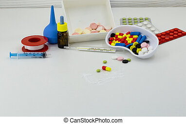 Medicine, pills of different colors on a white background, drugs health