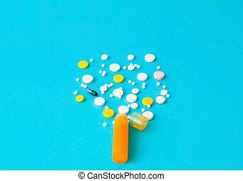 Medicine pills on blue background. Drug prescription for treatment medication