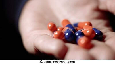 Medicine pills or capsules in hand, medicament, cure for...