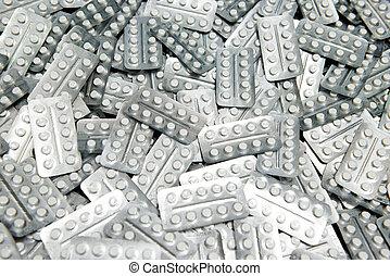 Medicine tablet pills in blister background