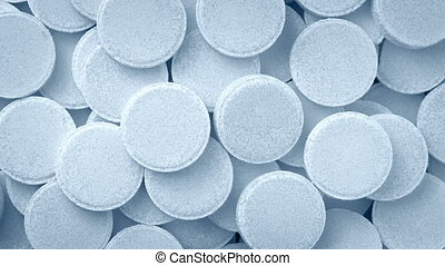 Medicine Tablets Rotating - Closeup overhead shot of...