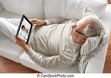 senior patient having video chat with doctor