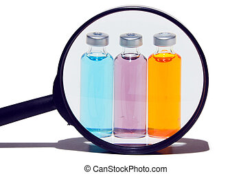 Prescription medicine vials under a magnifying glass