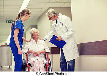 medics and senior woman in wheelchair at hospital -...