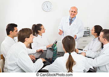 Medics at colloquium in clinic.