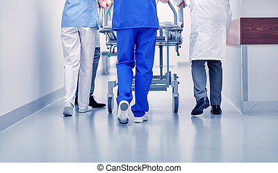 medics carrying hospital gurney to emergency room - ...