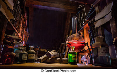 Medieval alchemist laboratory with various kind of flasks in...