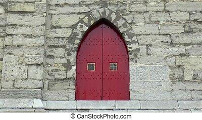 Medieval window: architectural detail at the Het Belfort van Gent, Ghent Belfry, Belgium.
