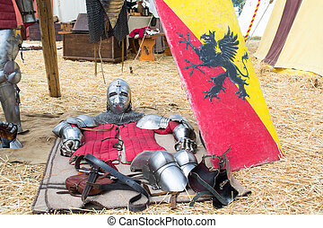 medieval armor lying on the ground - parts of medieval armor...