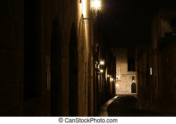 Medieval Avenue of the Knights at night, a cobblestone street in Rhodes Citadel , Greece