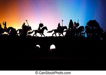 Medieval battle scene on bridge with cavalry and infantry....