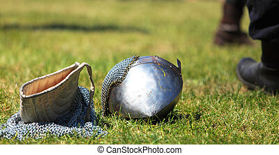 Medieval battlefield abstract - Image of a steel helmet and...