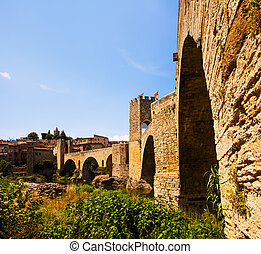 medieval bridge with gate and old town. Besalu, Catalonia