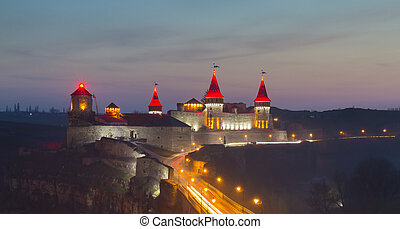 Medieval castle at night. Kamenets-Podolsky, Ukraine