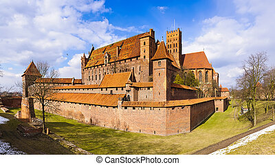 medieval castle in malbork, poland - panorama landscape with...