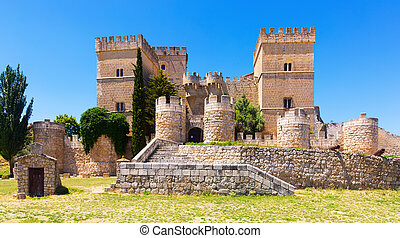 Medieval castle of Ampudia in sunny summer day. Palencia, ...