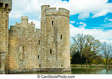Medieval castle tower surrounded by moat