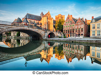Medieval cathedral and bridge over a canal in Ghent - Gent, Belgium