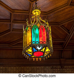 Medieval ceiling chandelier in the Gothic style of multi-colored pieces of glass.