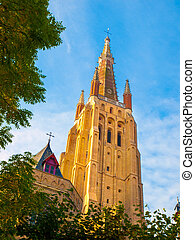 Medieval Church of Our Lady in Bruges on sunny day, Belgium.