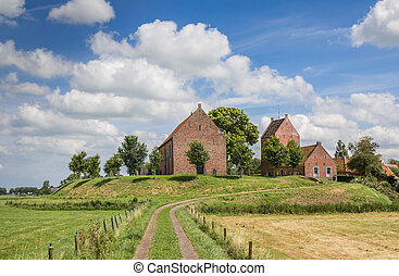 Medieval church on a mound in Groningen village Ezinge