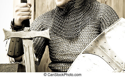 Medieval crusader knight with sword and shield.