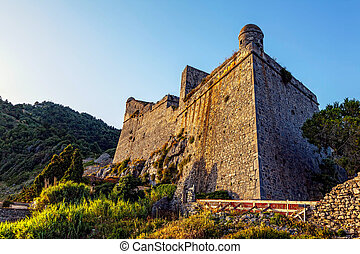 Medieval Doria Castle at sunset in the Italian town of Portovenere