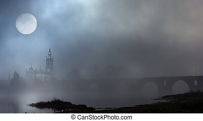 Medieval fog - Church and stone bridge of medieval city of...