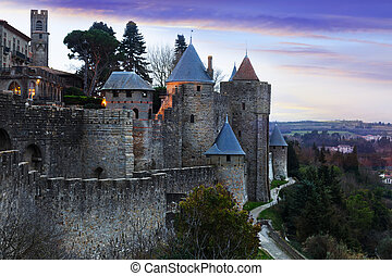 Medieval fortness walls in evening. Carcassonne, France