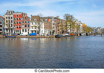Medieval houses along the river Amstel in Amsterdam the ...