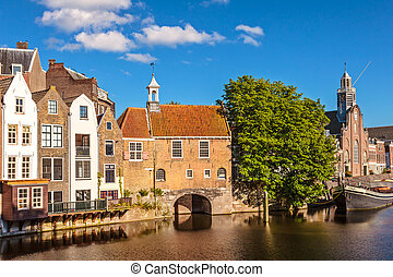 Medieval houses alongside a canal in Delfshaven, The...