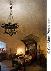 Medieval interior, detail from the Golden lane in Prague's...